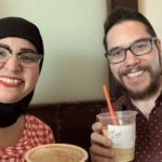 Mona and Eric sip coffee while planning for Annual Meeting 2019: Leading with Equity And Diversity (L.E.A.D.)